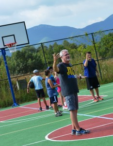 Dave teaching basketball with the campers during Indian Camps